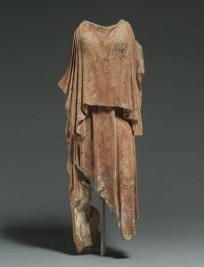 Fifth century terra cotta depicting a woman wearing a peplos